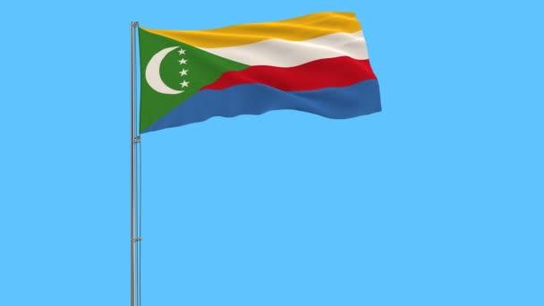 Elkülöníteni a zászlórúd, csapkodott a szélben a kék háttér, 3d rendering a Comore-szigetek zászlaja.