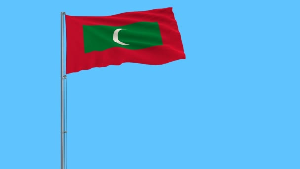 Flag of Maldives on the flagpole fluttering in the wind on a transparent pure blue background, 3d rendering, png format with alpha transparency