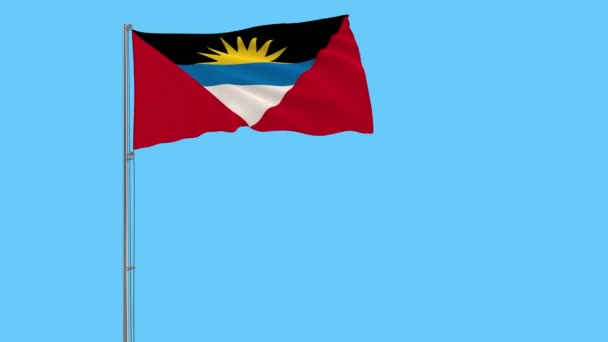 Isolate flag of Antigua and Barbuda on a flagpole fluttering in the wind on a blue background, 3d rendering