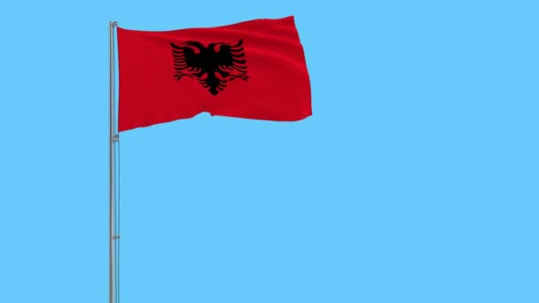 Isolate flag of Albania on a flagpole fluttering in the wind on a blue background, 3d rendering