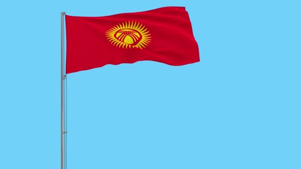 Isolate flag of Kyrgyzstan on a flagpole fluttering in the wind on a blue background, 3d rendering