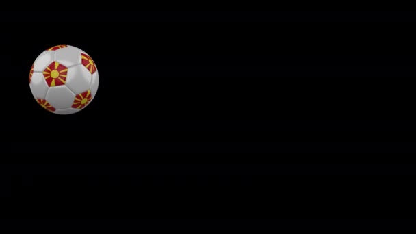 Macedonia flag on flying soccer ball on transparent background, alpha channel