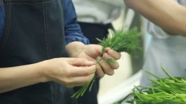 slow motion cookers plucked dill in industrial kitchen at restaurant