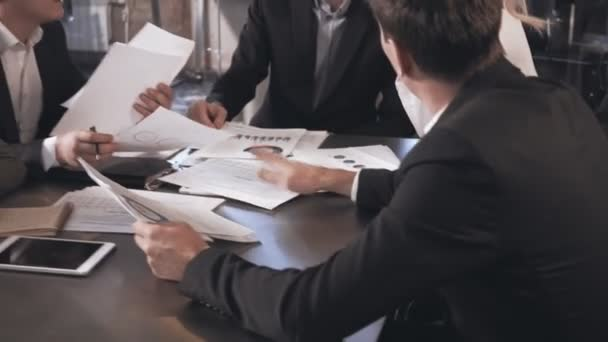 Business people exchanging documents, closeup shot