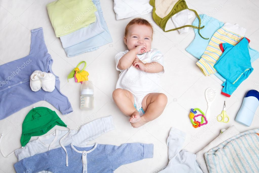 14af6eec4b2b Baby on white background with clothing