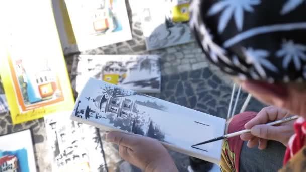 Pouliční umělec, kresba
