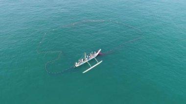 Aerial footage of fishermen at work in Sri Lanka. Slowmotion footage in 4k