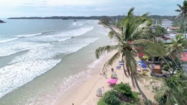 Aerial footage of the Weligama Bay in Sri Lanka. Slowmotion footage in 4k