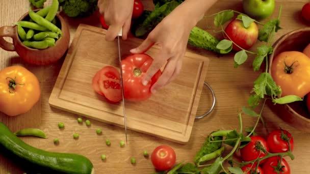 Slicing red tomato