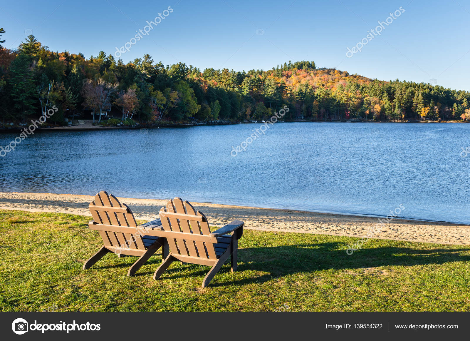 Brown Adirondack Chairs in Front of a Lake at Sunset — Stock ...