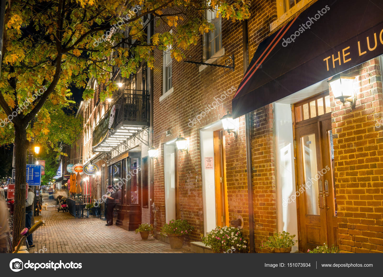 Sidewalk Lined With Restaurants And Shops In Old Town Alexandria Va
