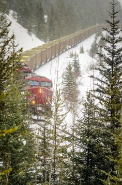 Goods Train during a Heavy Snowstorm in the Mountains