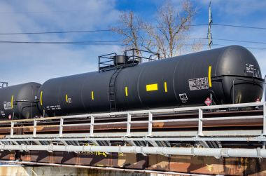 Rail Tank Car for and Blue Sky with Clouds