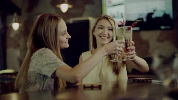 women clinking glasses