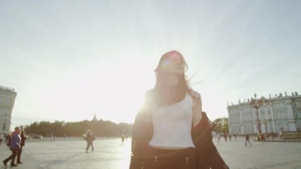 Stylish woman posing at the city sights