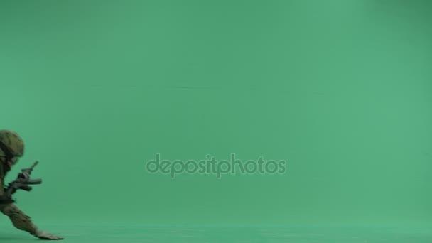 Soldier creeping at green screen