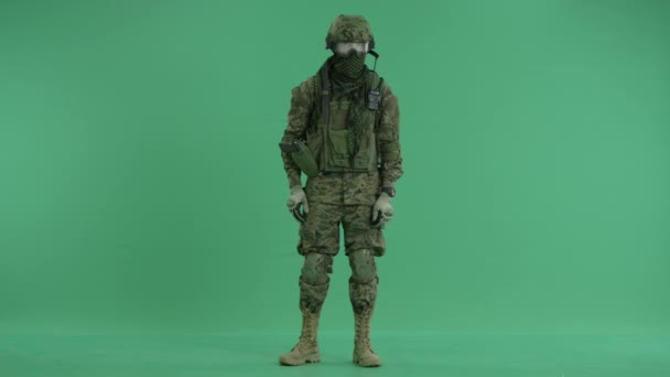 Soldier crossing hands at green screen