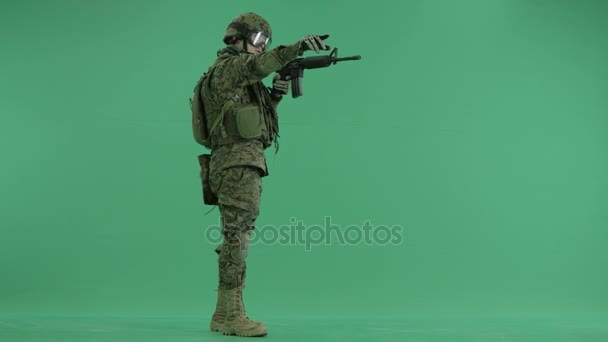 Soldier moving his hands and weapon at green screen