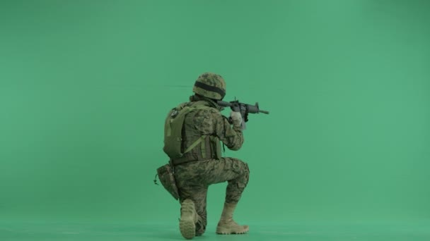 Soldier targets sitting back at green screen