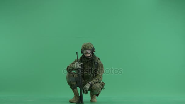 serviceman showing gesture peace at green screen
