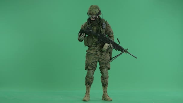 Soldier talking on cellphone at green screen