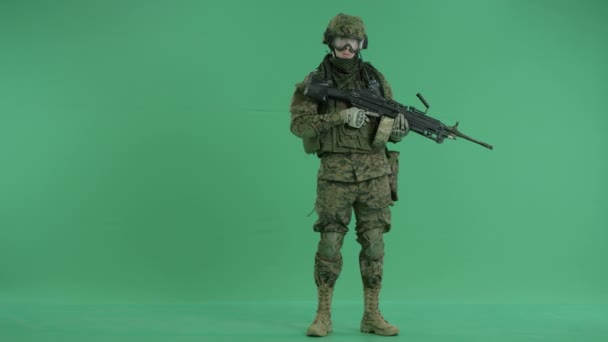 Soldier thumbing down at green screen