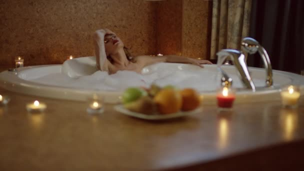 beautiful woman lying in bath with foam