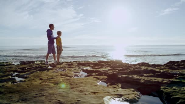 Brothers are looking at wonderful landscape on a coast