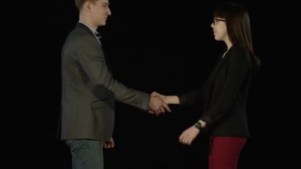 Two Young Business People Meet Shake Hands And Talk Then Go Away