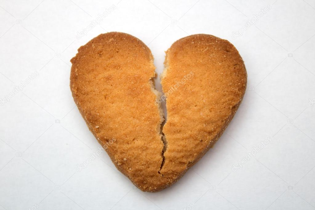 Cookie In The Form Of Broken Hearts Symbol Of Love Stock Photo