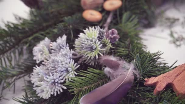 Creating a Christmas wreath with decorations. Close-up.