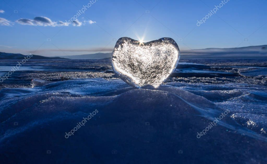 Icy heart in the waves in the light of sunset. lake Baikal