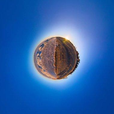 Double sphere sandy beach and the ice of Lake Baikal. Spherical