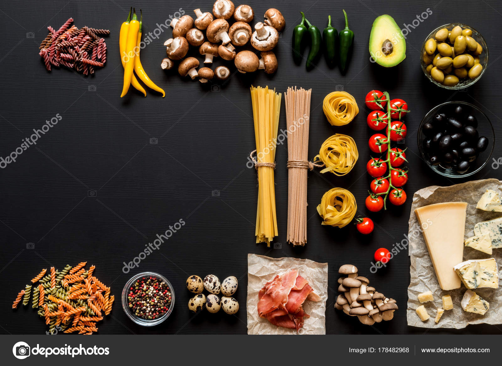 Different fresh ingredients for cooking italian pasta spaghetti different fresh ingredients for cooking italian pasta spaghetti fettuccine fusilli and vegetables on a black background with free copy space forumfinder Gallery