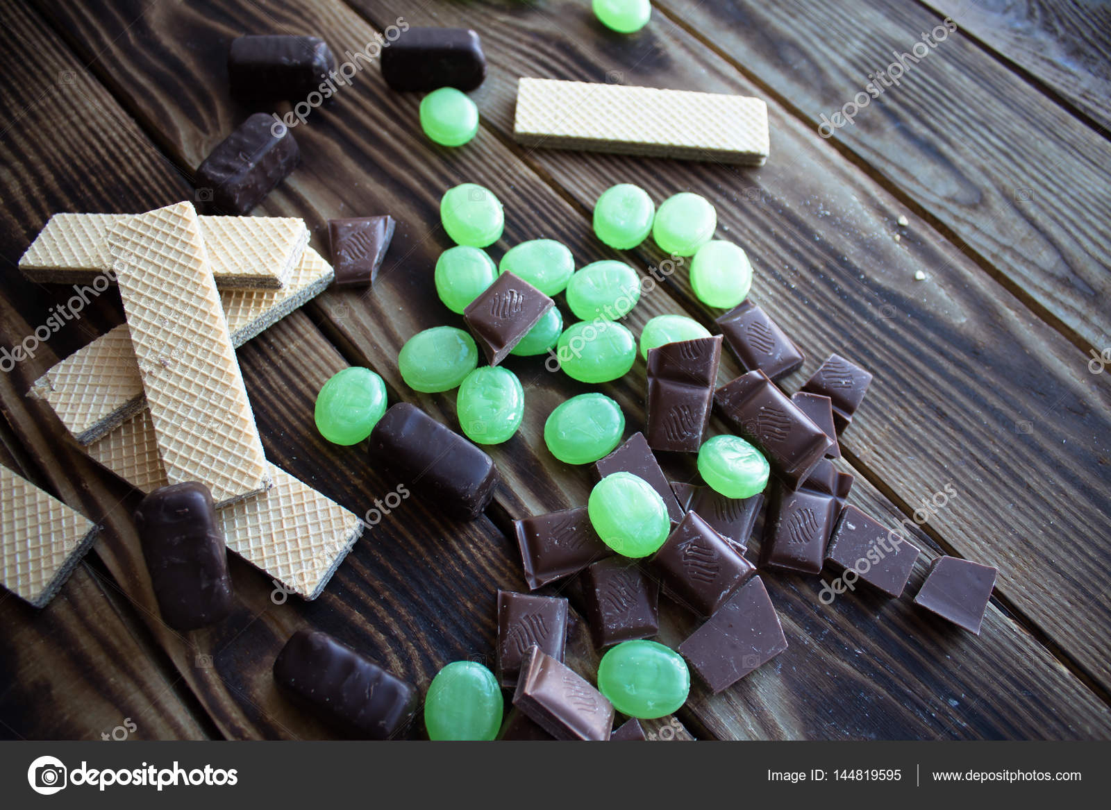Chocolate candy wafer and measuring tape — Stock Photo