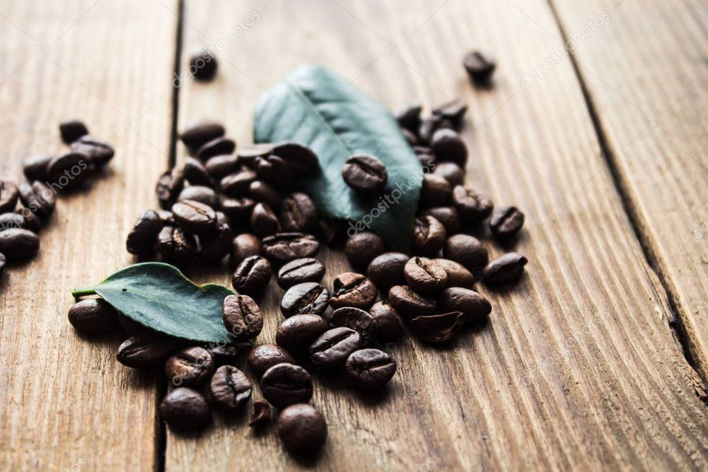 coffe beans and green leaf