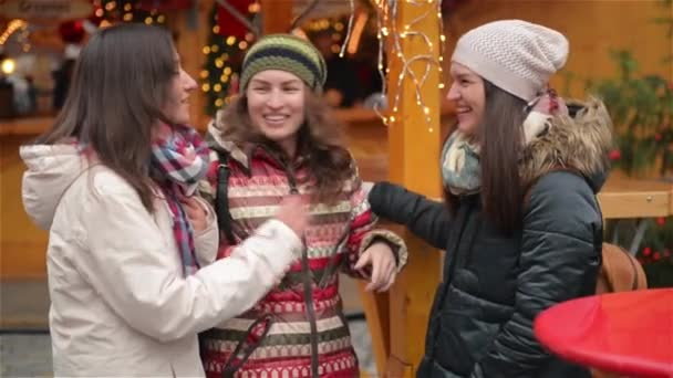 Portrait of Laughing Girlfriends Having Fun on the Christmas Market. Happy Friends Spends Time Together During the Winter Holidays