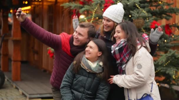 Group of Smiling Man and Women Taking Selfie Outdoors near Xmas ...