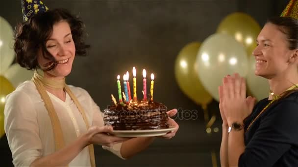 Birthday Girl Holding A Chocolate Cake With Candles And Trying To