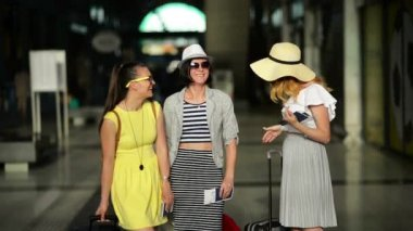 Three Attractive Girls Going to Travel Together During Summer Vacation. Amazing Ladies with Tickets for a Plane are Standing Inside the Airport.