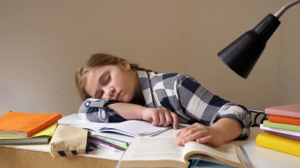 Girl fell asleep doing homework. Distance learning during quarantine
