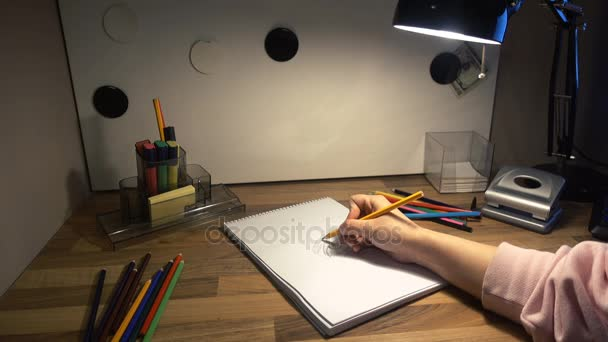 female hand drawing on a sheet of paper with a pencil 4k