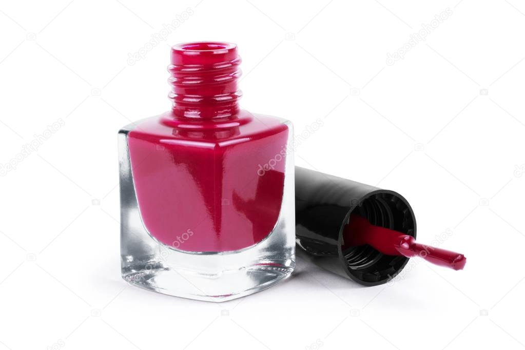 dark pink nail polish on a white background