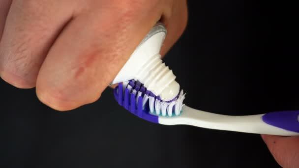 Tooth brush with tooth paste on black background