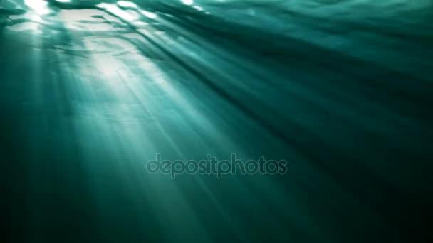 Vysoce kvalitní Looping animace oceánu vlny od realistické pod vodou. Světelné paprsky, které svítí skrz