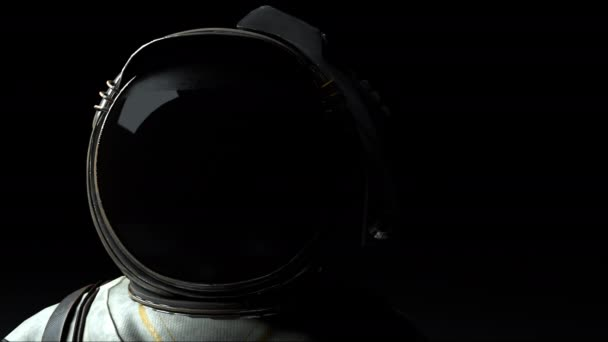 Astronaut in a metal helmet close-up in the light and dark. Computer generated space background, 3D rendering