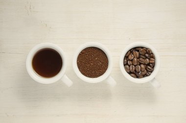 Coffee. Coffee cups and coffee beans.