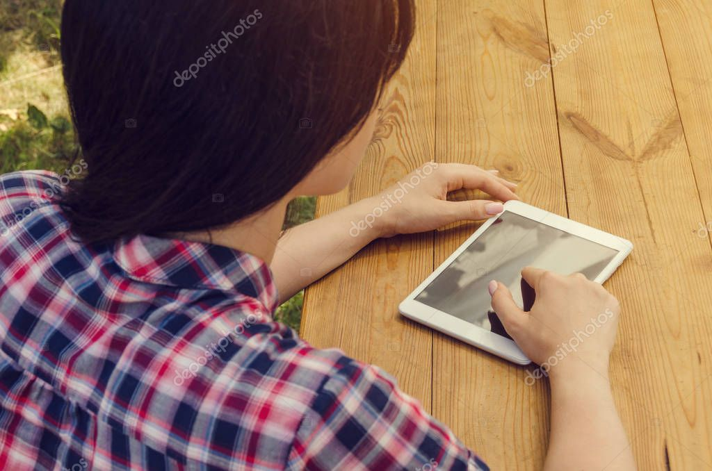 Young beautiful woman in casual shirt and tablet.  Portrait. Sum