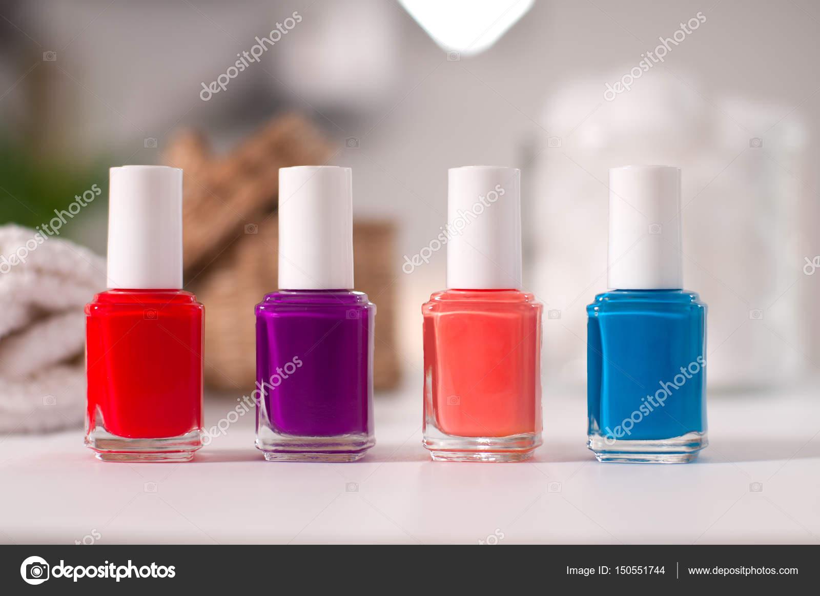 Bottles of colorful nail polish on a table — Stock Photo © flisakd ...
