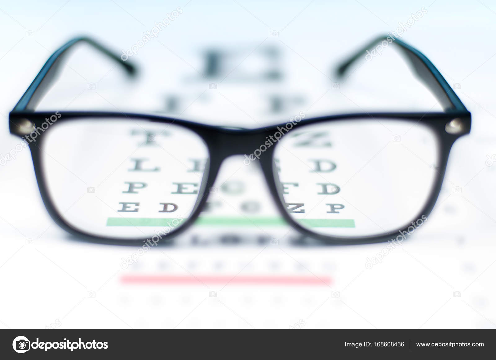 Eye vision test chart seen through eye glasses stock photo eye vision test chart seen through eye glasses prescription glasses sitting on an eye test chart photo by flisakd geenschuldenfo Image collections